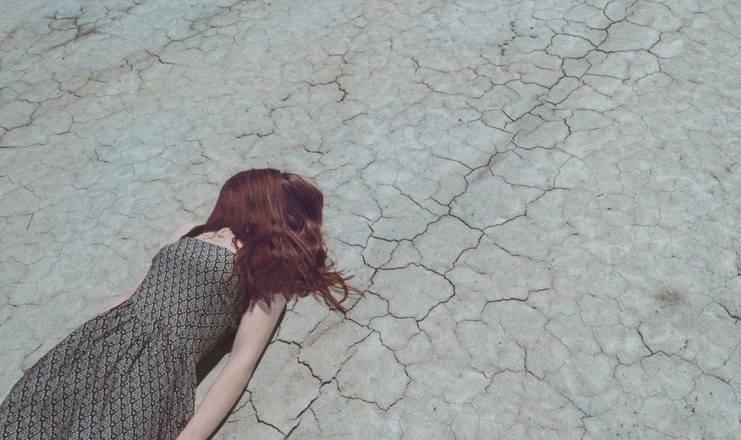 Girl on cracked earth